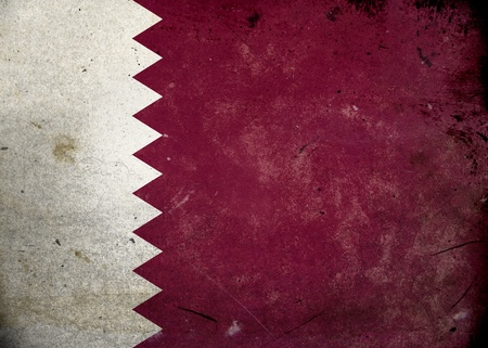 national border: Flag of Qatar on old and vintage grunge texture