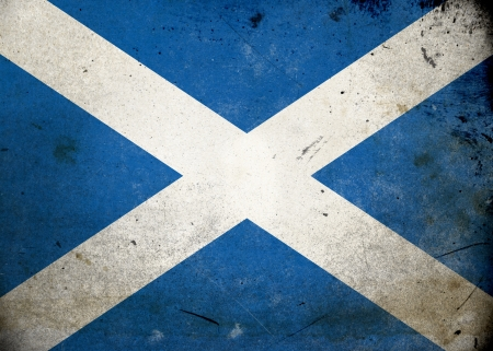 Flag of Scotland on old and vintage grunge texture photo