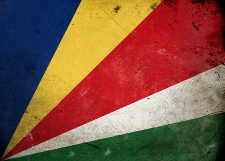 Flag of Seychelles on old and vintage grunge texture photo