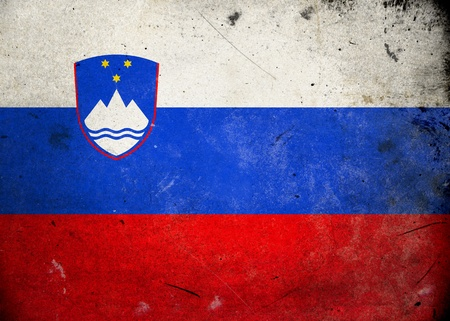 Flag of Slovenia on old and vintage grunge texture photo