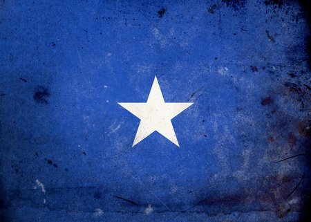 Flag of Somalia on old and vintage grunge texture photo
