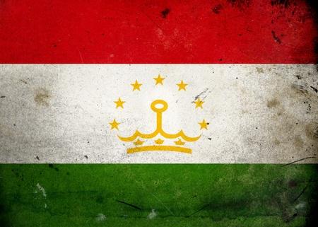 Flag of Tajikistan on old and vintage grunge texture photo