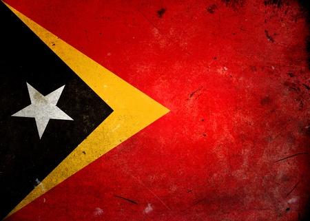 Flag of Timor Lesta (East Timor) on old and vintage grunge texture photo