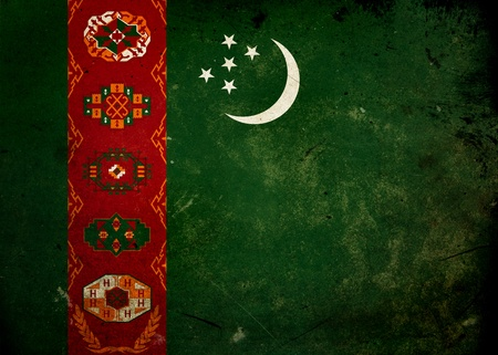 Flag of Turkmenistan on old and vintage grunge texture photo