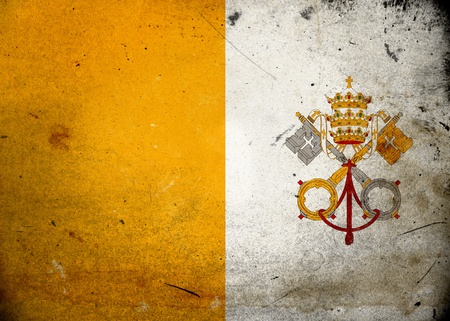 Flag of the Vatican City on old and vintage grunge texture photo