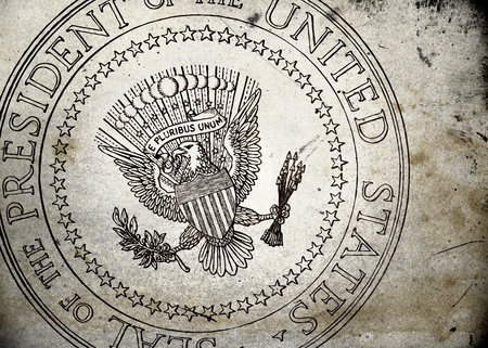 Presidential Seal of the USA on old and vintage grunge texture photo