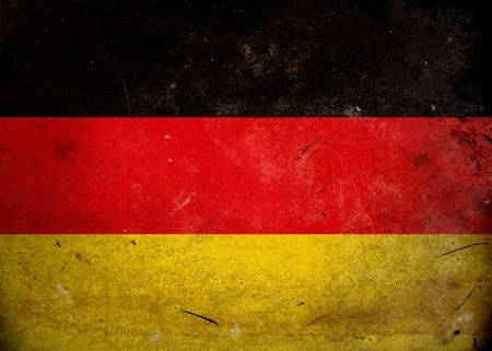 The flag of Germany on old and vintage grunge texture photo