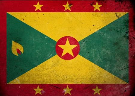 The flag of Grenada on old and vintage grunge texture photo