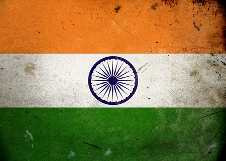 The flag of India on old and vintage grunge texture photo