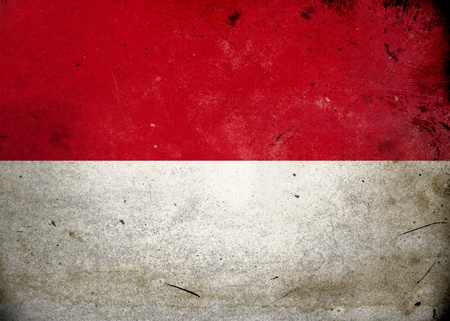 the indonesian flag: The flag of Indonesia on old and vintage grunge texture