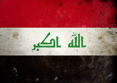 The flag of Iraq on old and vintage grunge texture photo