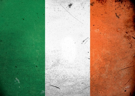 The flag of Ireland on old and vintage grunge texture photo