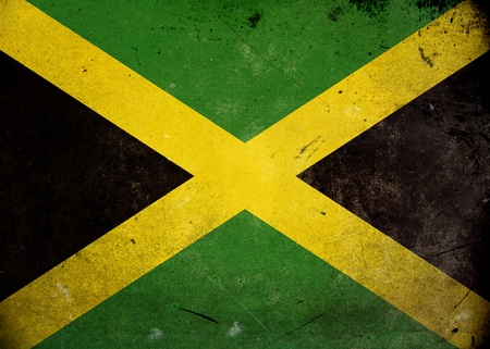 The flag of Jamaica on old and vintage grunge texture photo
