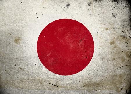 bandera japon: La bandera de Jap�n en la textura del grunge de edad y de la vendimia
