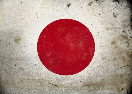 The flag of Japan on old and vintage grunge texture photo