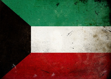 The flag of Kuwait on old and vintage grunge texture photo