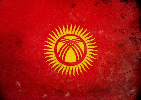 kyrgyz republic: The flag of Kyrgyzstan on old and vintage grunge texture
