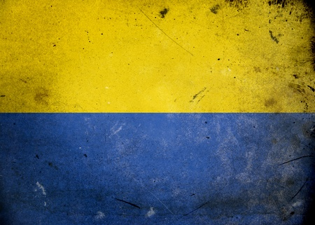 Flag of Ukraine on old and vintage grunge texture photo