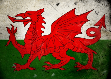 welsh flag: Flag of Wales on old and vintage grunge texture Stock Photo