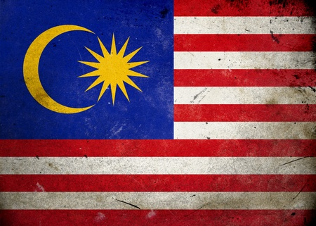 Flag of Malaysia on old and vintage grunge texture