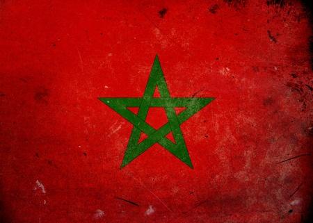 Bandera de Marruecos en la textura del grunge de edad y de la vendimia