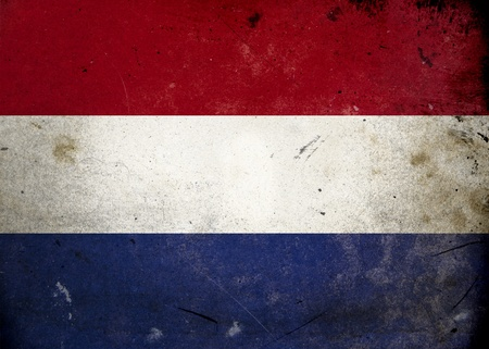 Flag of the Netherlands on old and vintage grunge texture photo