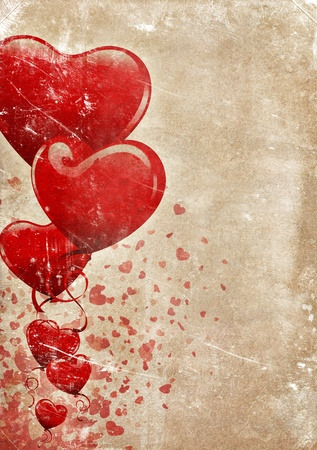 Heart-shaped baloons and confettis on a grunge old paper background with lots of copyspace for your text photo