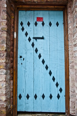 Old blue door with red number plate from Istanbul, Turkey photo