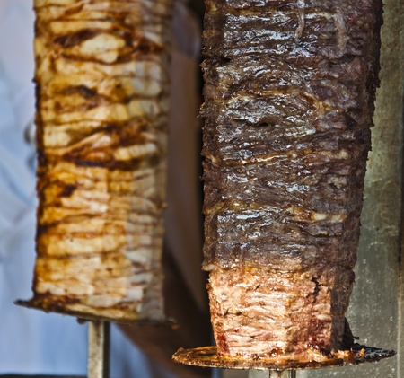 Delicious Turkish Kebab made with meat in the front and chicken in the background photo