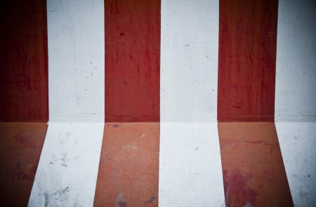 Grunge texture of an abstract wall painted in red and white photo