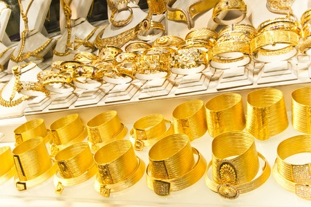 costume jewelry: Golden accessories in the display window of a jewellery store Stock Photo