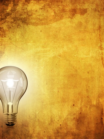 filament: A light bulb on grunge paper background, idea and creativity concept