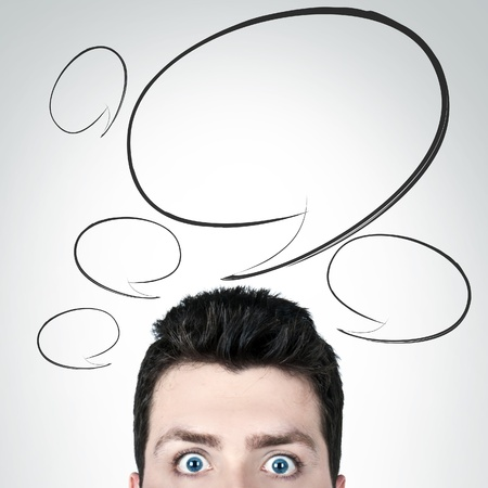 Young man surprised with wide open eyes and copy space Stock Photo - 13770913