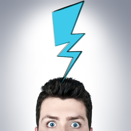 Young man surprised with wide open eyes and a thunder icon above his head Stock Photo - 13770907