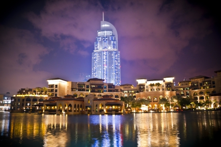 FEB 27- DUBAI, UAE   A nightshot of the Address Hotel and the luxurious buildings of Souk al Bahar with reflection on the water