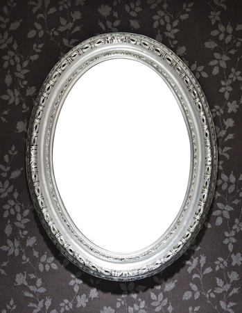 silver picture frame: Blank mirror frame on a wall covered with floral wallpaper, clipping paths included