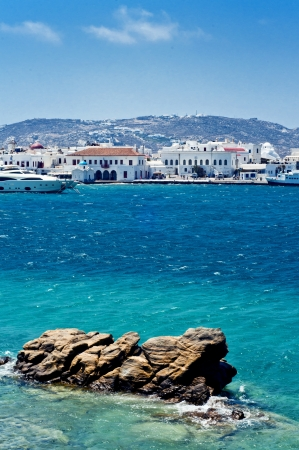 Mykonos island with whitewash little houses, tiny churches and beautiful old windmills in summertime