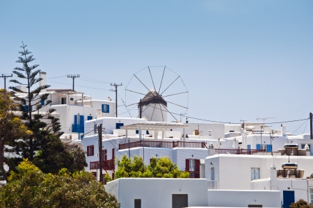 Mykonos island with whitewash little houses, tiny churches and beautiful old windmills in summertime photo