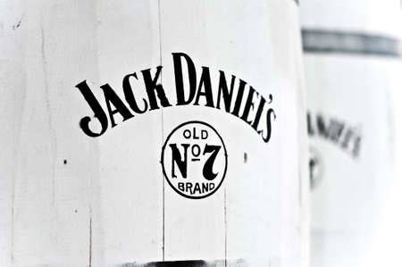 jack up: Jack Daniel s whiskey barrels close up - Editorial use only