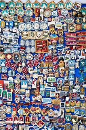 Plenty of antique medals pinned on a board