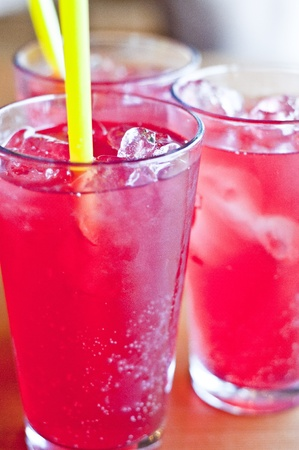 Red cold drinks with ice cubes photo
