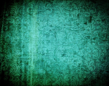 turquoise background: Beautiful grunge background with light effect and floral designs