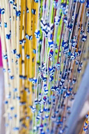 Bracelets with evil eye beads photo