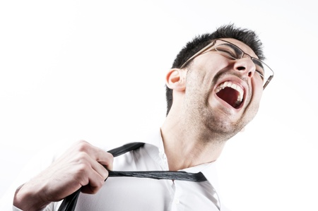 Young business man pulling his necktie and screaming, isolated on white photo