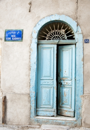 Image of traditional wooden Tunisian door with relief ornaments photo