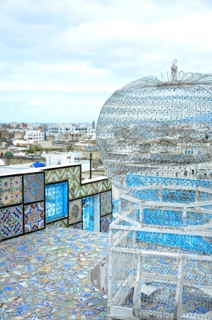 Traditional authentic birdcage in enormous size on a beautifully tiled terrace with the view of Medina, Tunis Stock Photo - 17375398