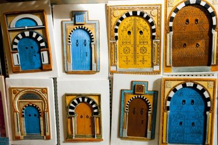 Decorative figurines of colorful Tunisian doors photo