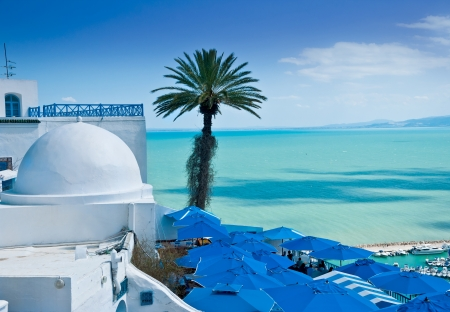A view of Sidi Bou Said, traditional Tunisian architecture and the beautiful Mediterranean Sea photo