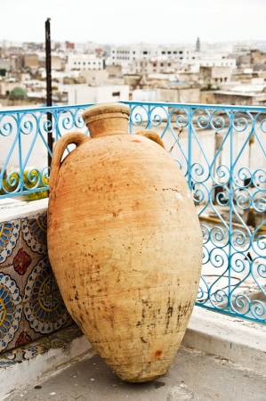 Ancient earthenware pot in a Tunisian terrace photo