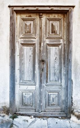 erosion: Ancient door in Syros Island, Greece Editorial